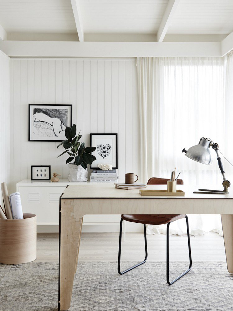 plywood desk in this white home office Home Office: How To Create A Scandinavian Feeling
