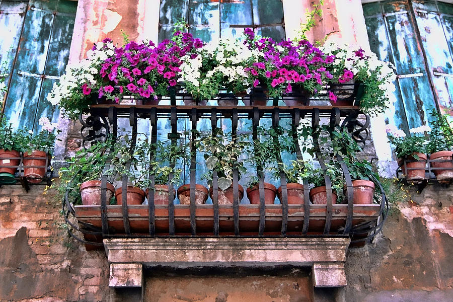 flowers on a balcony 35 Worlds Most Beautiful Balconies