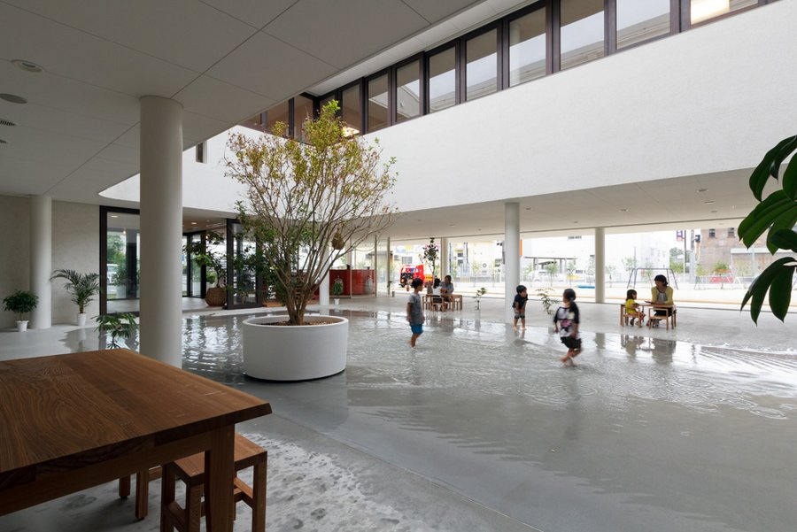 preschool in japan by youji no shiro 5 HIBINOSEKKEI + Youji No Shiro / Preschool that collects rainwater into a puddle