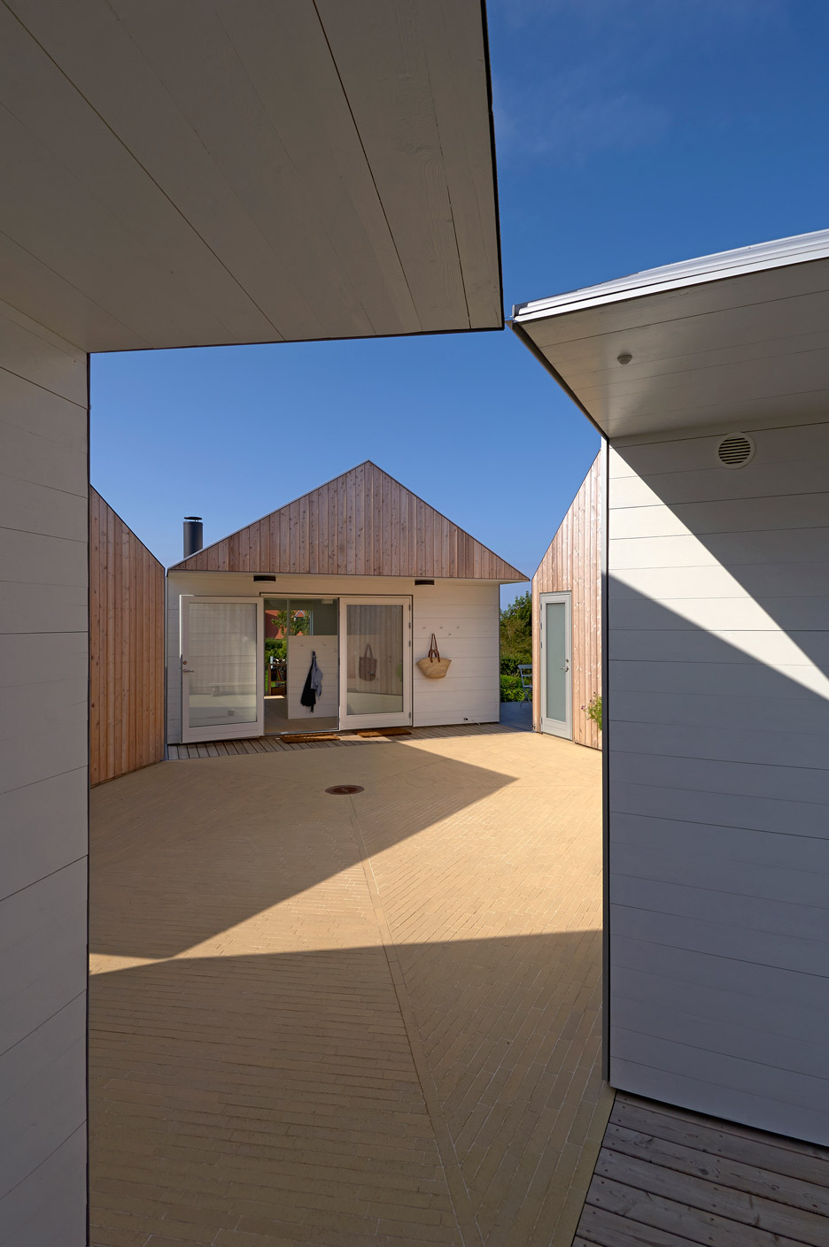 1 Building Was Split Into 5 To Create A Courtyard For A Family