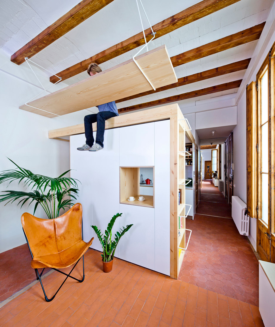 Wooden Desk is Hanging From the Ceiling in this Apartment In Barcelona