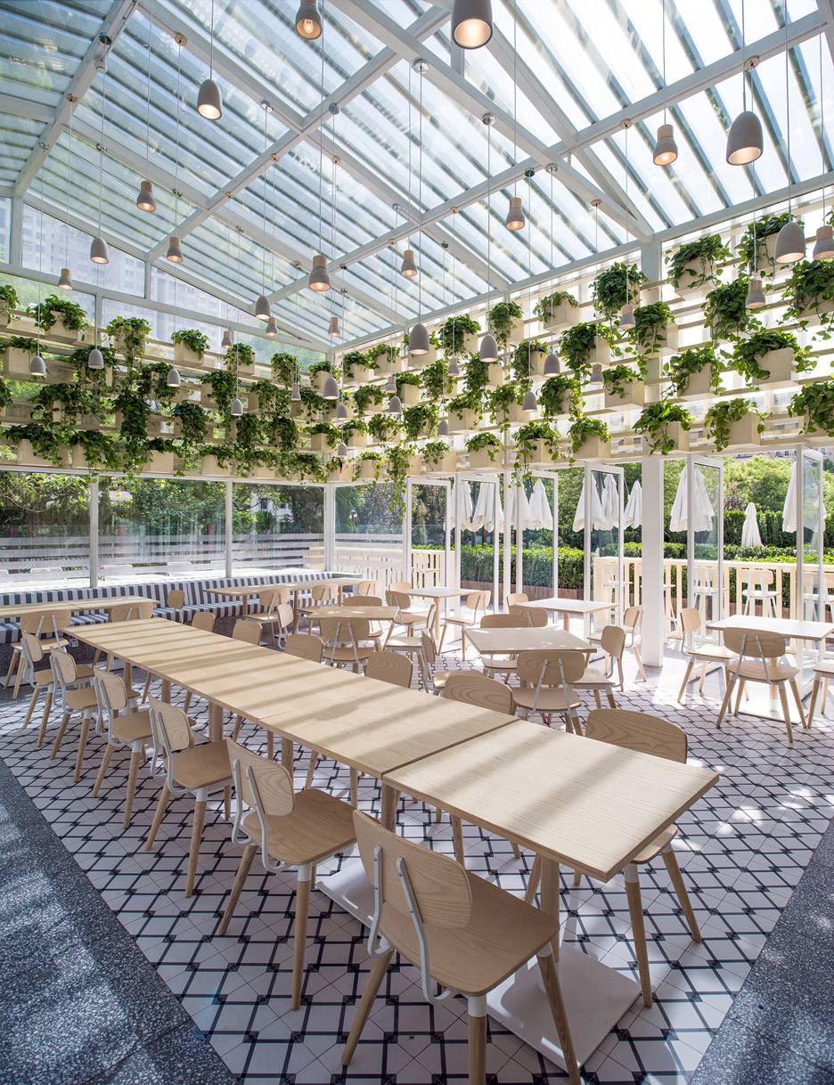 Transformed Greenhouse Into Plant Lined Coffee Shop By The
