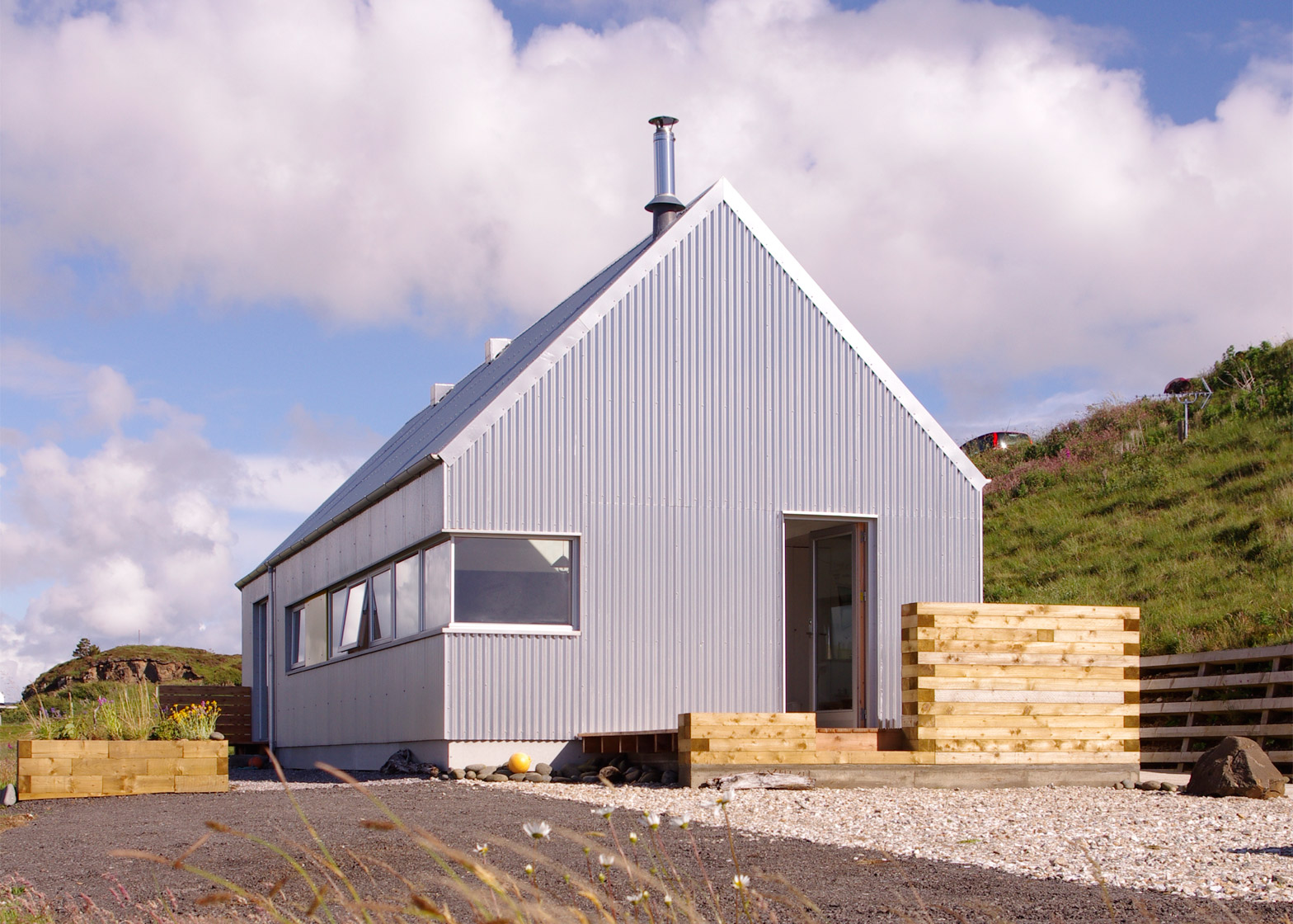 The tinhouse is a holiday home on the scottish island for Tin roof house designs