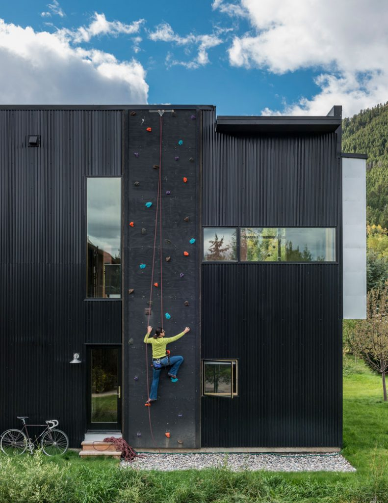 modern black house with rock climbing wall 791x1024 22 Awesome Rock Climbing Wall Ideas For Your Home
