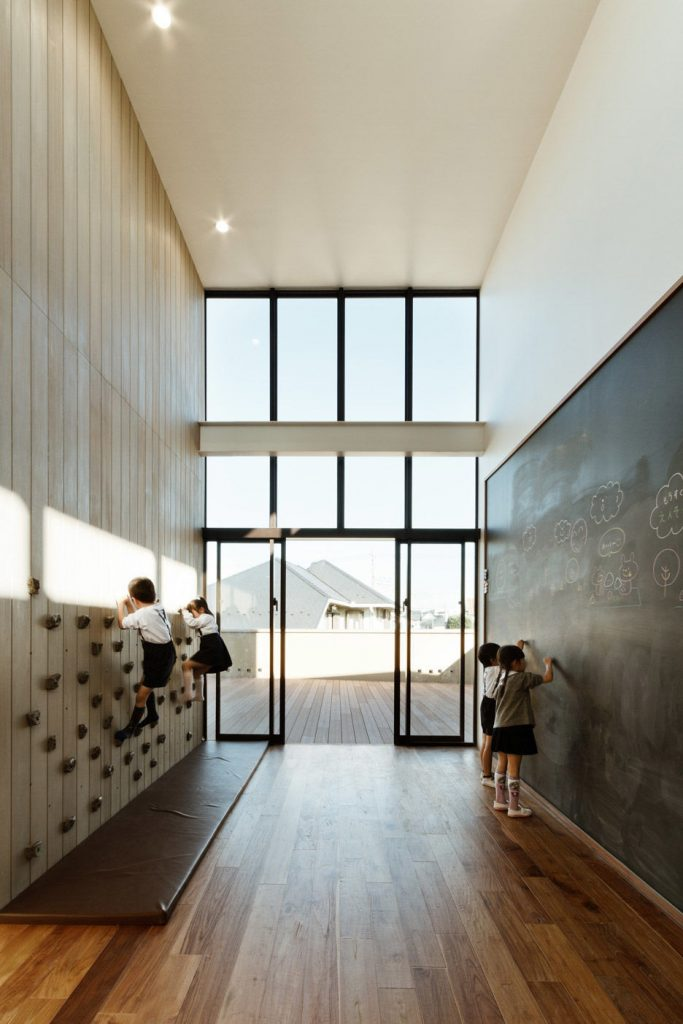 rock climbing wall in school 683x1024 22 Awesome Rock Climbing Wall Ideas For Your Home