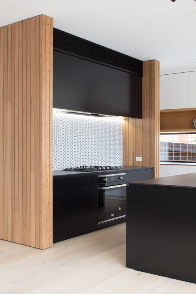black kitchen cabinets 683x1024 Home Additions: How these Architects Made it Look Easy