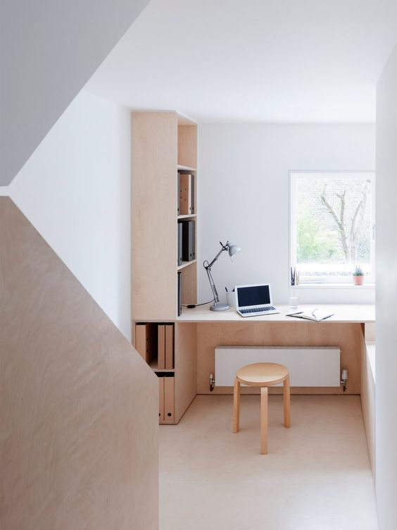minimalist home office by larissa johnston How To Create A More Productive Home Office Environment