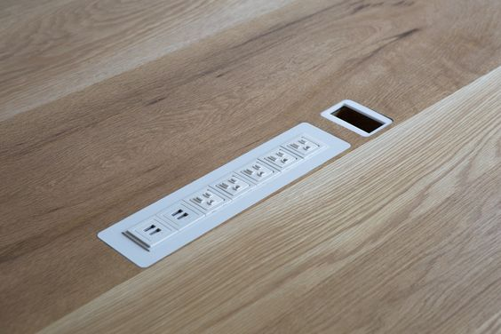 power outlets in a table How To Create A More Productive Home Office Environment