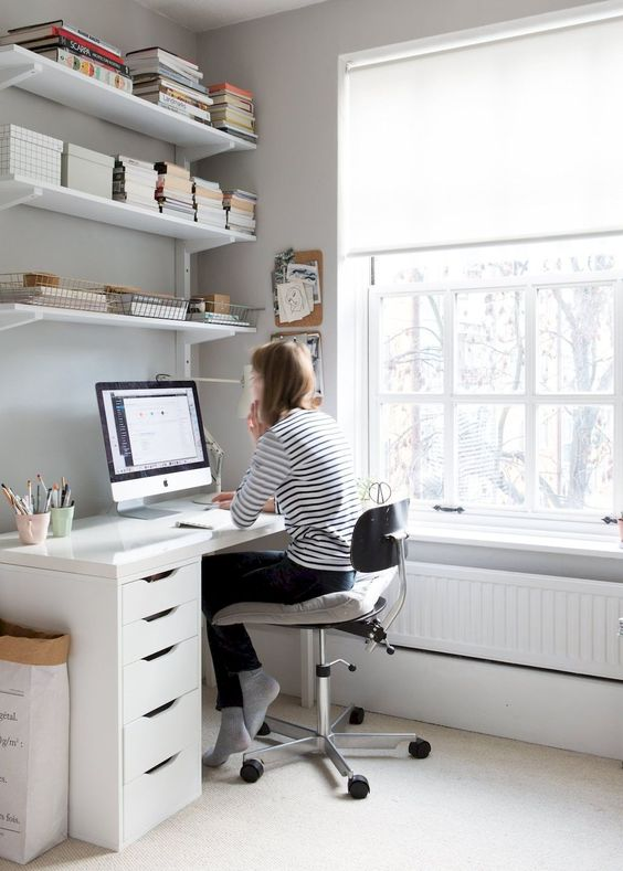 workspace with some shelving How To Design The Perfect Office For Your Home