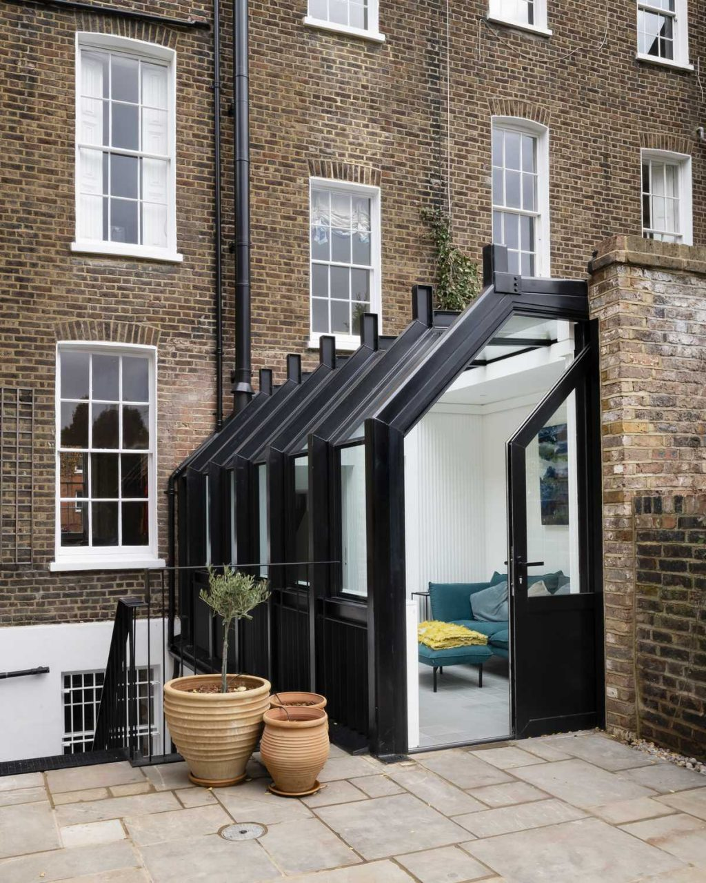 A glasshouse re-connects a Listed townhouse to its garden
