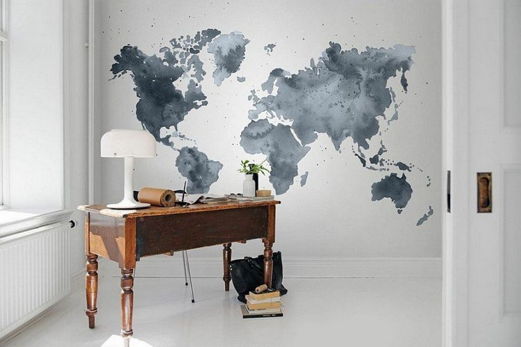 watercolor world map on the wall and an antique wooden desk in this minimalist home office Home Office: How To Create A Scandinavian Feeling