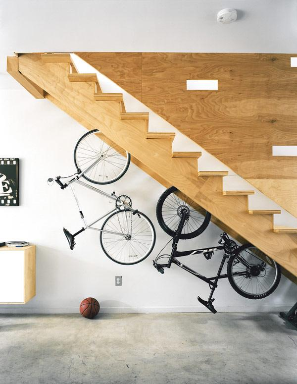 built in bicycle racks in a staircase designed by postgreen architects Bike Storage Ideas: 30 Creative Ways of Storing Bike Inside your Home