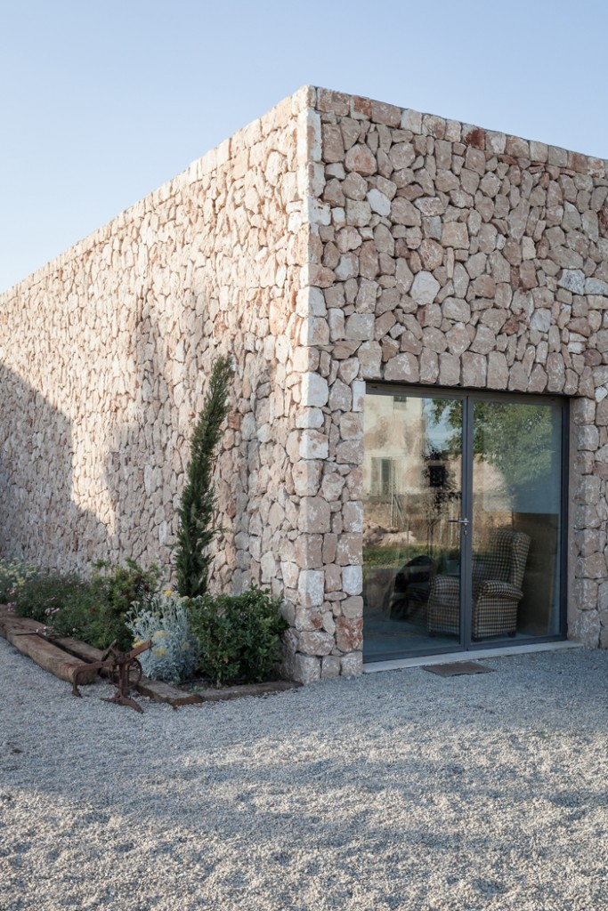 an old farmhouse transformed into an art studio and gallery in mallorca 12 683x1024 Exterior Wall Cladding Ideas for Your Home