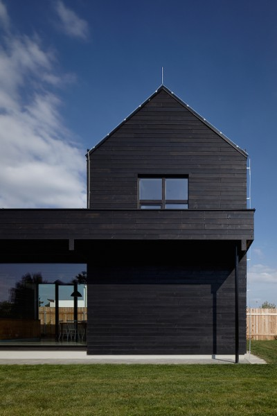 Blue Shipping Container Serves As a Storage Place In This House