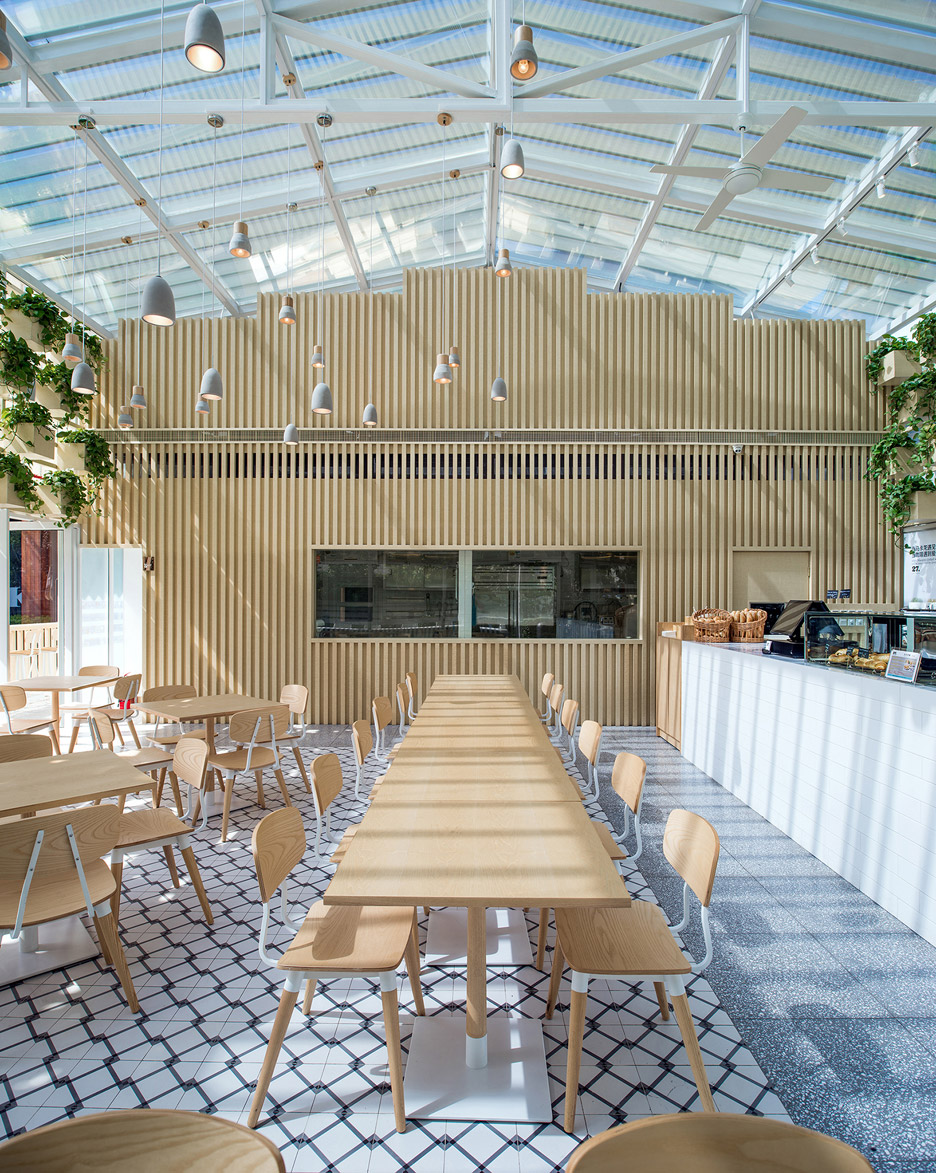 transformed greenhouse into plant lined coffee shop by the four o nine architects 3 Transformed greenhouse into plant lined coffee shop by the Four O Nine architects
