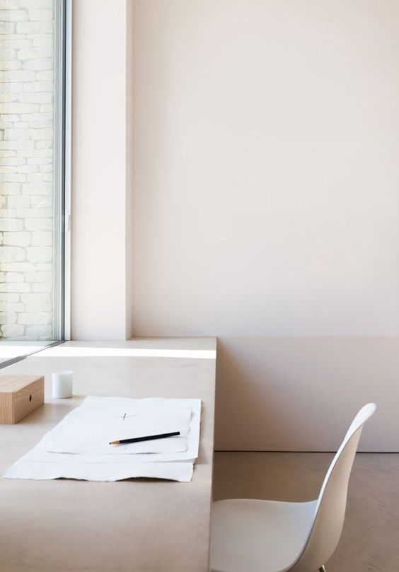 minimalist empty desk How To Create A More Productive Home Office Environment