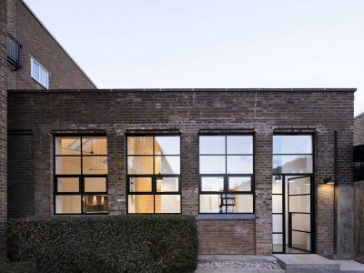 Dilapidated warehouse conversion into a light-filled house