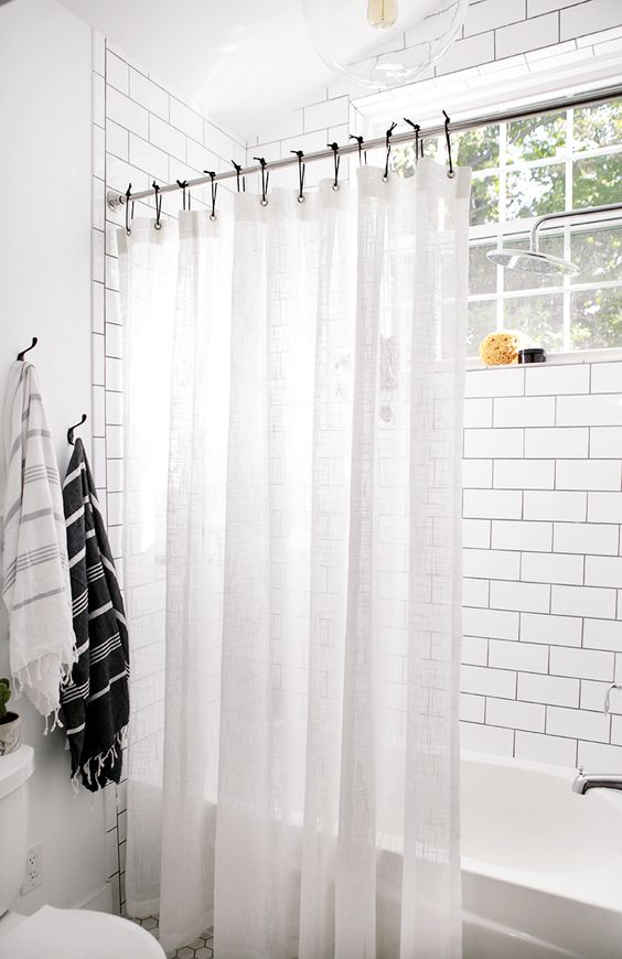 white shower curtain 8 Low Cost Ideas for Creating a Unique Home Interior