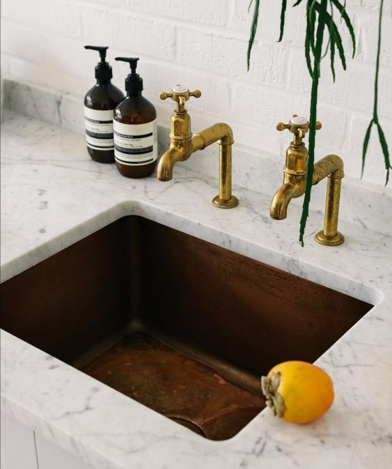 copper sink and marble countertop 4 Things to Consider When Designing Your Kitchen