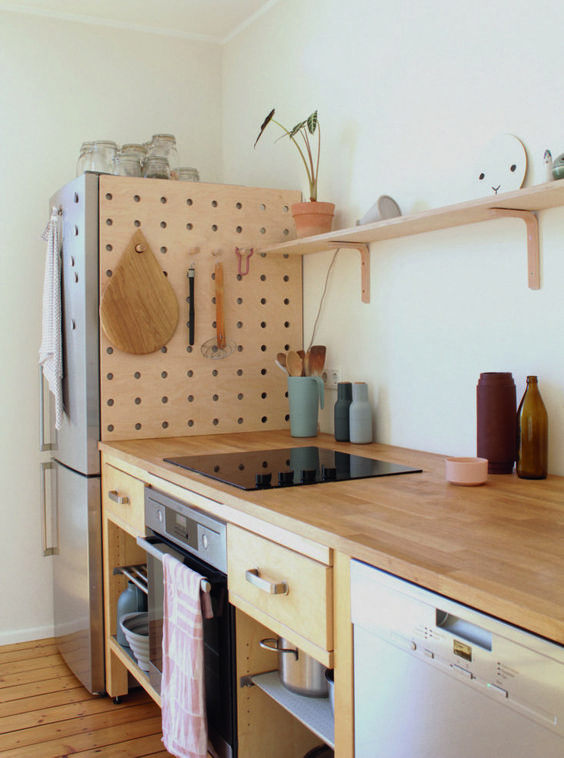 a pegboard hides the gap behind the fridge These 40+ Kitchen Decor Ideas Will Inspire You To Renovate Yours
