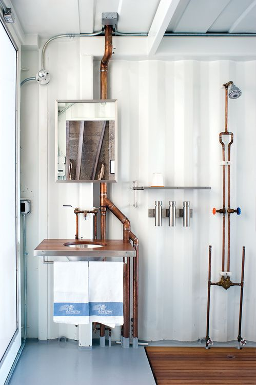 guest bathroom featuring exposed copper piping Different Types of Plumbing Services