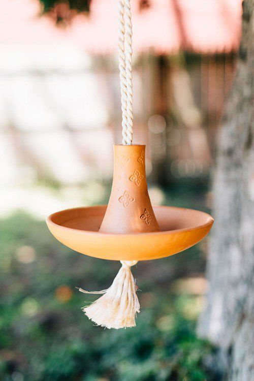 hanging clay feeder 25 Best Bird Feeders To Attract Birds To Your Garden