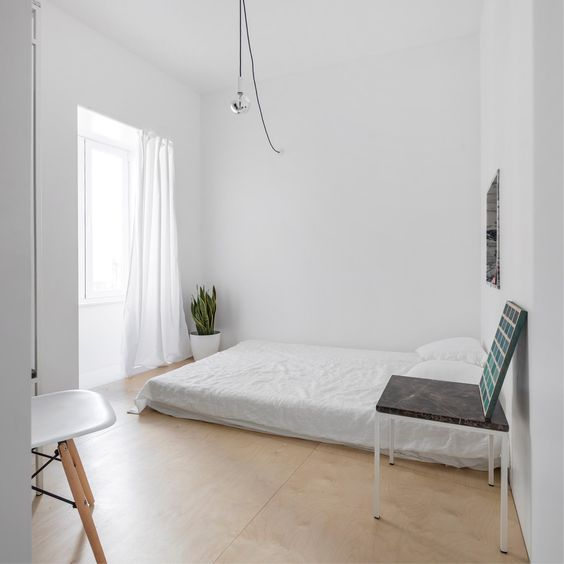 minimal bedroom with a floor mattress Make Your Bedroom Eco Friendly With These Upgrades
