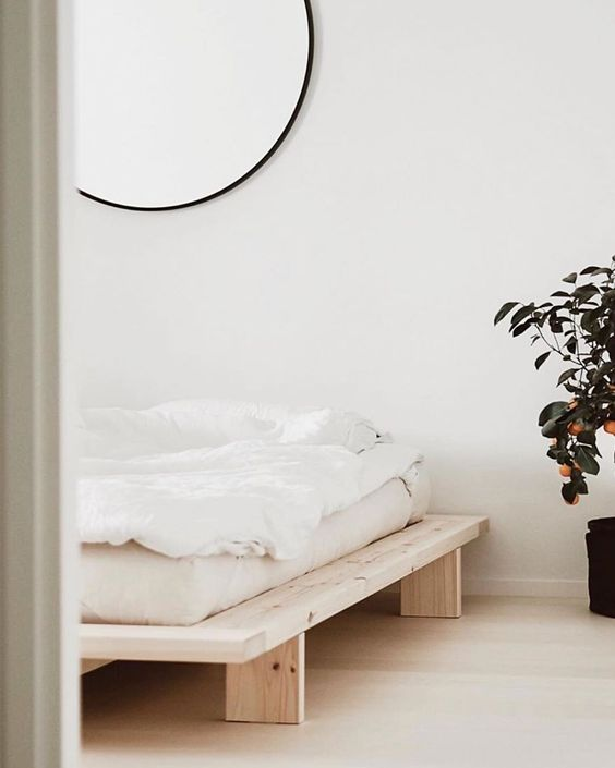 minimalist wooden bed frame and a mattress Buying A New Mattress? Check Out These Tips To Get Started