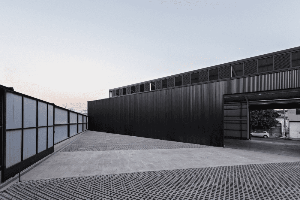 minimalist black warehouse by moarqs Top 7 Reasons to Invest in Industrial Roof Cleaning
