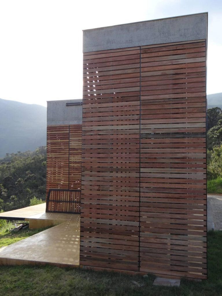 a sequence of closed louvres 768x1024 A Modern Concrete House In Brazil With Stunning Views Of The Sierra da Moeda