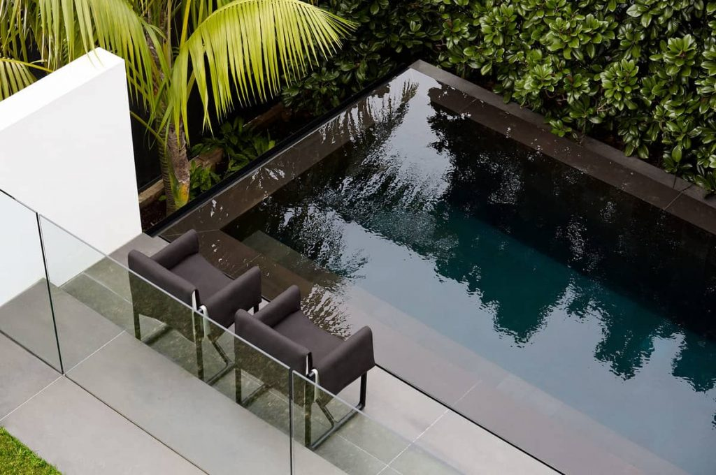 basalt lined swimming pool 1024x680 A House Designed Around the Sculptural Form Of a Large Angophora Tree