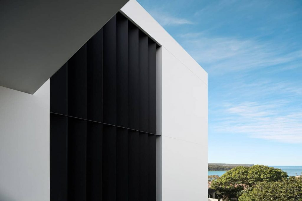 blackened steel brise soleil facade detail 1024x680 A House Designed Around the Sculptural Form Of a Large Angophora Tree