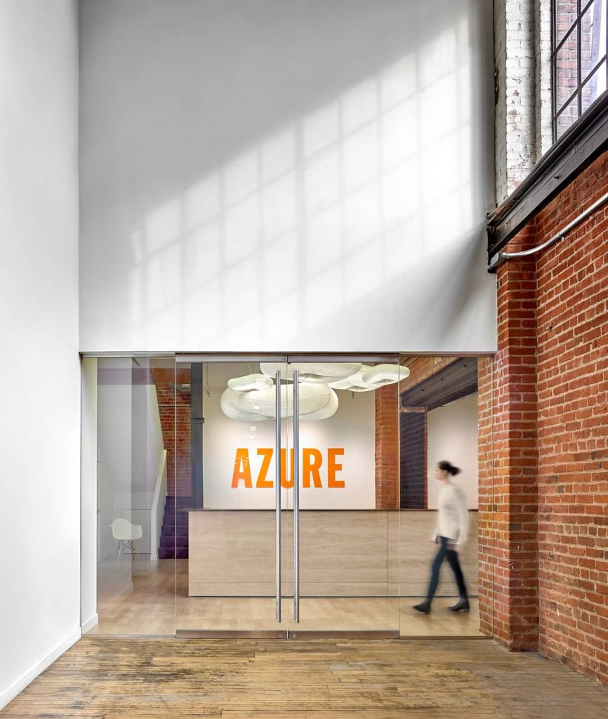reception and logo 866x1024 An Old Transformer Factory Was Converted into a Bright Office