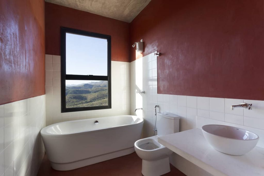 the red restroom 1024x683 A Modern Concrete House In Brazil With Stunning Views Of The Sierra da Moeda