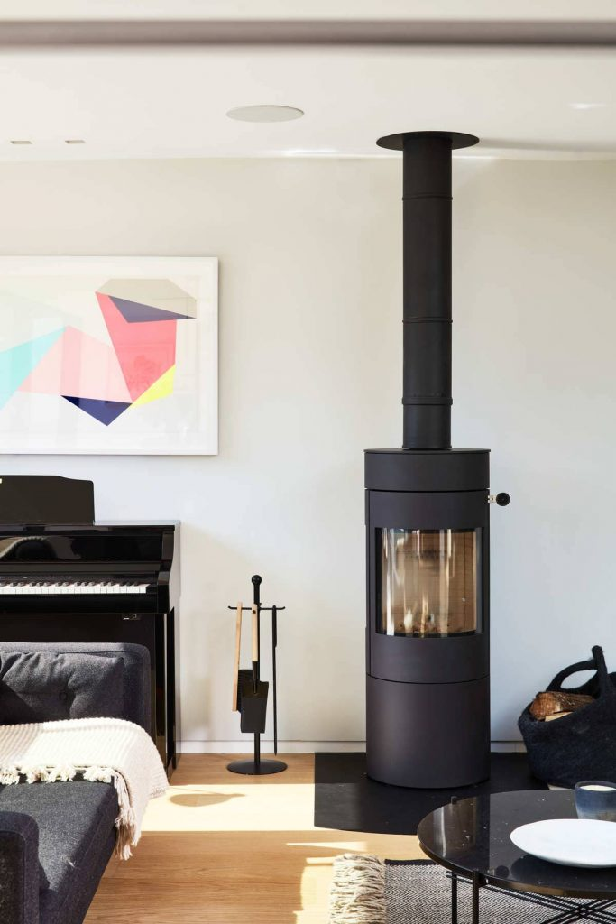 wood burning stove 683x1024 An Accessible House Designed By COX Architects