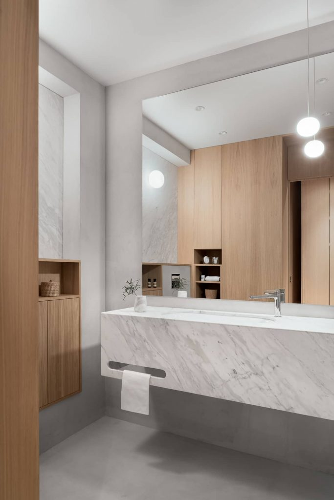 a double faced bespoke joinery defines the bathroom enclosure 683x1024 A Two Bedroom Flat Was Reconfigured Into a Modern Apartment