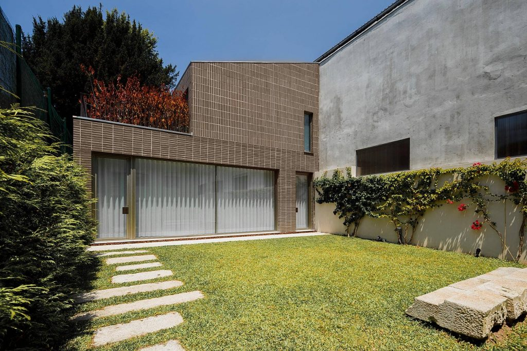 backyard 1024x683 Miguel Bombarda Residential Building by Paula Santos Arquitectura
