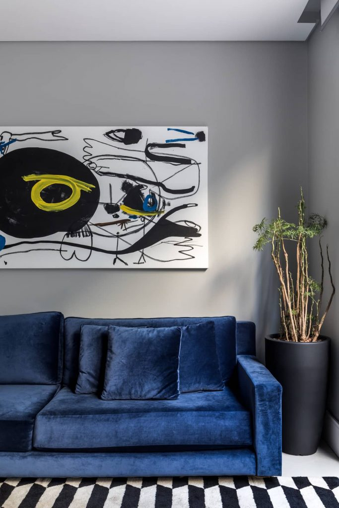blue couch 683x1024 Colorful Apartment Interior by TN Architecture