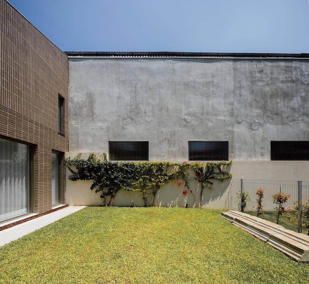 brick and white facade 1024x942 Miguel Bombarda Residential Building by Paula Santos Arquitectura