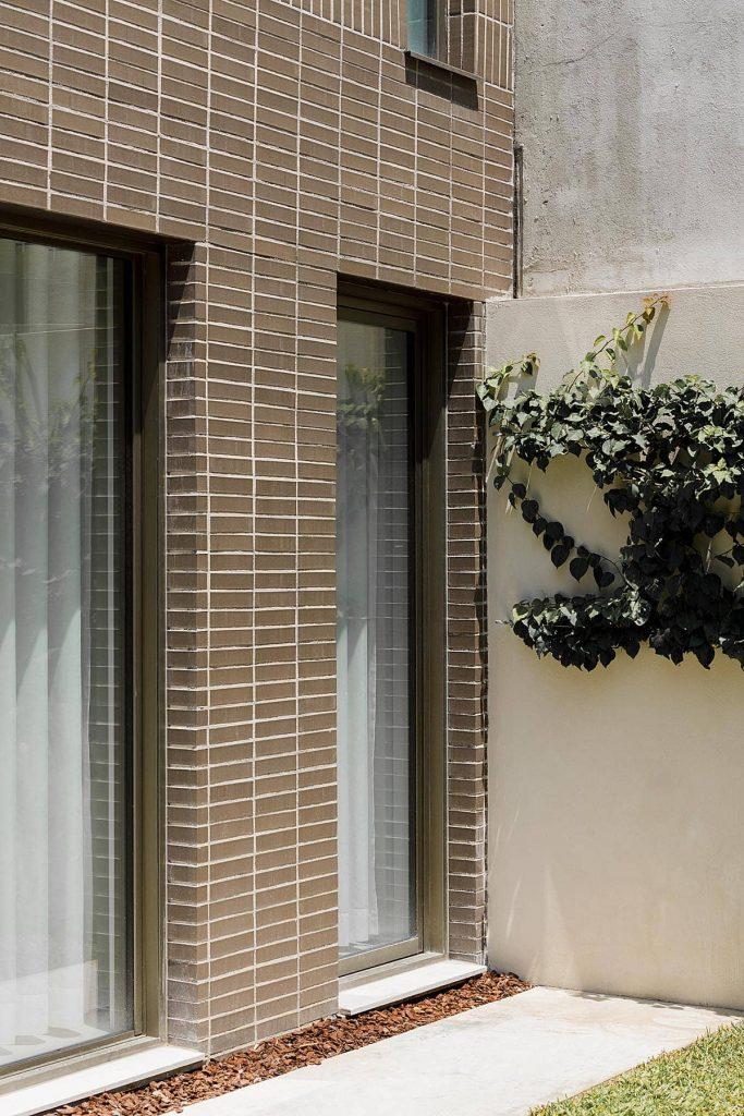 brick cladding 683x1024 Miguel Bombarda Residential Building by Paula Santos Arquitectura