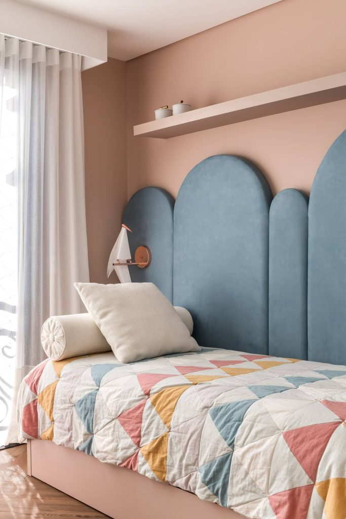 daughters bedroom with a blue headboard 683x1024 Colorful Apartment Interior by TN Architecture