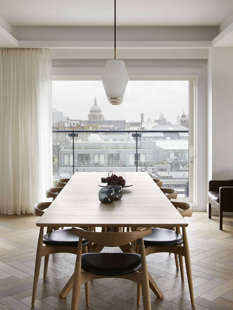 dining area with a view onto london st paul cathedral 769x1024 An Airy Living Space in London by Patalab Architecture