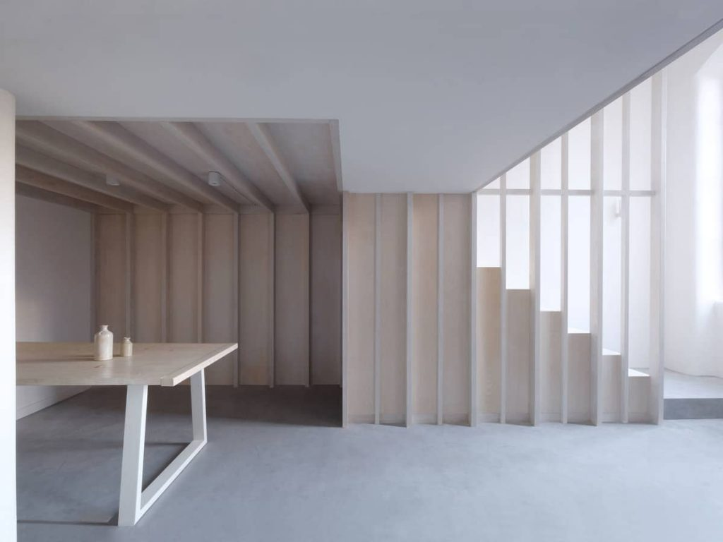 dining space and stairs 1024x768 A Converted Matchstick Factory Becomes a Beautiful Apartment