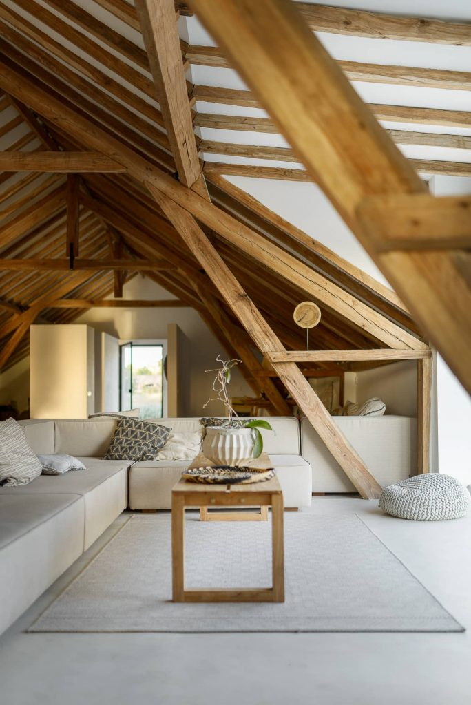 exposed wooden beams 684x1024 Enter Arquitectura Converts an Old Warehouse Into a Family Home