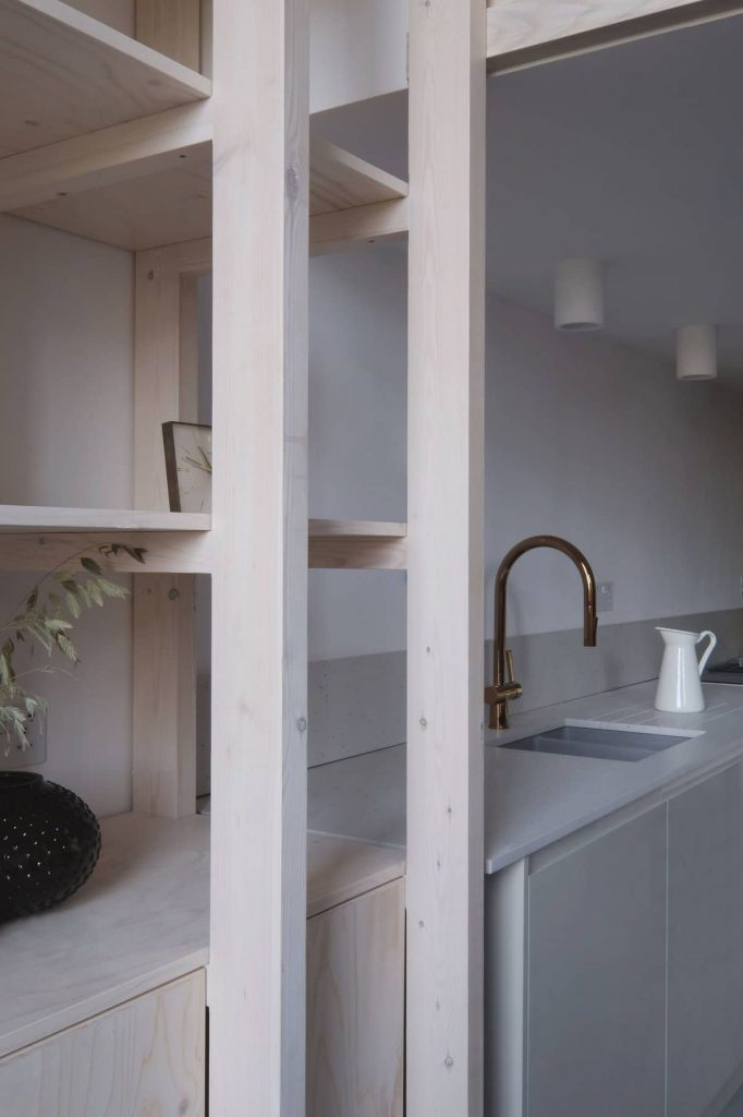 kitchen and storage 682x1024 A Converted Matchstick Factory Becomes a Beautiful Apartment