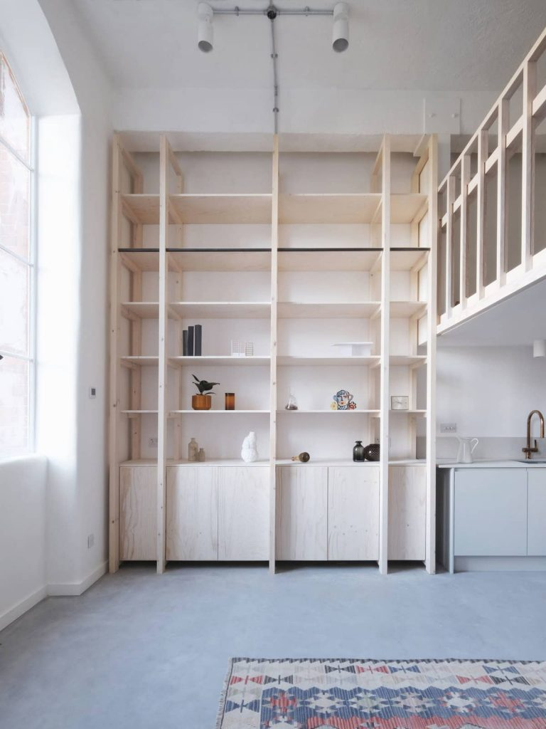 mezzanine and storage shelves 768x1024 A Converted Matchstick Factory Becomes a Beautiful Apartment