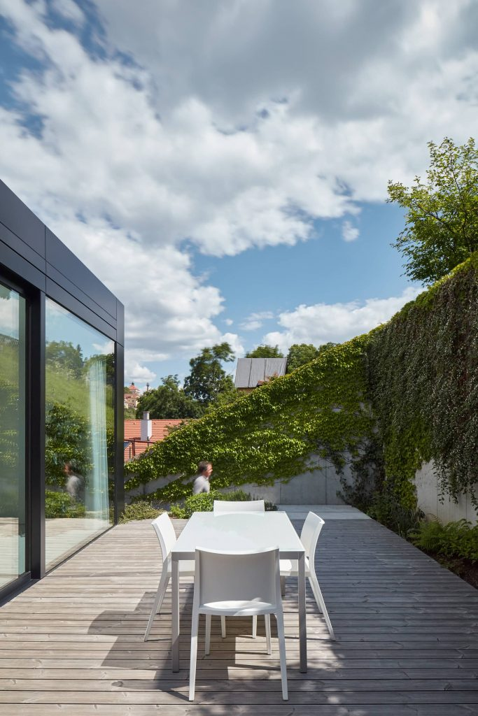 outdoor terrace 683x1024 Family House With a Green Roof in the River Valley