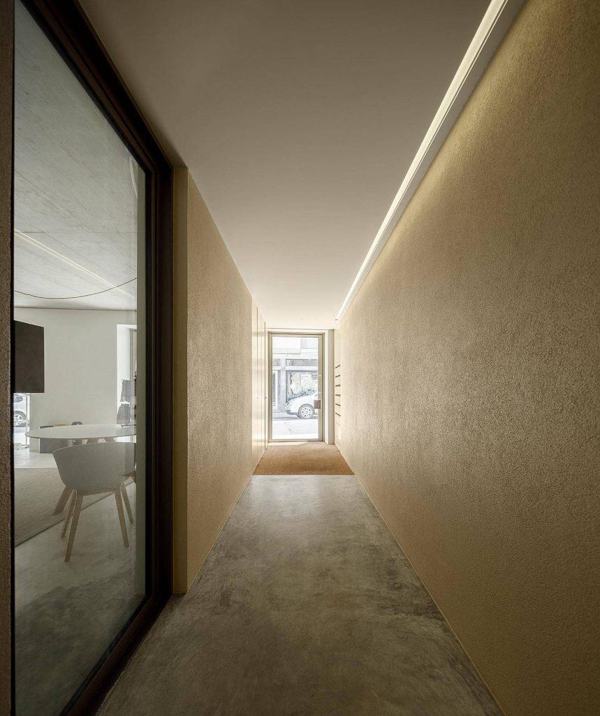 spacious corridor 859x1024 Miguel Bombarda Residential Building by Paula Santos Arquitectura