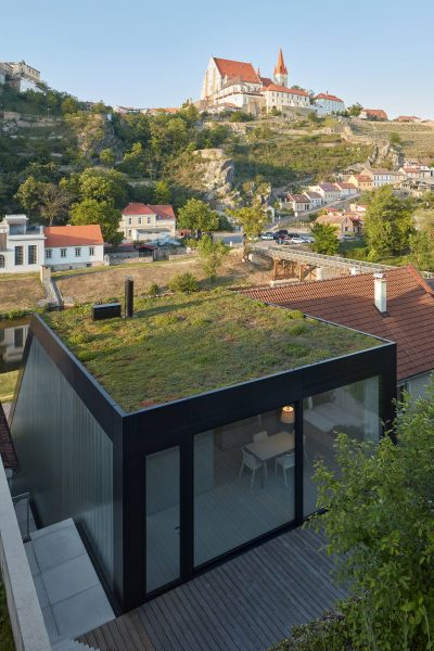 Family House With a Green Roof in the River Valley