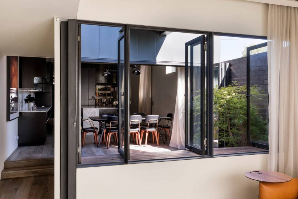 the view to the kitchen and living room 1024x683 A Zinc Clad Addition by Robert Simeoni Architects
